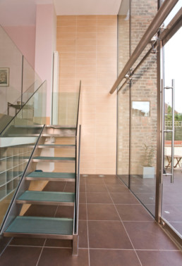 Internal View of structural glazed atrium with glass and steel staircase