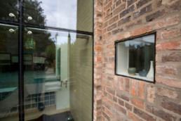 Detail of structural glass and fixed light in listed building, family home in York