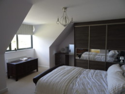Bedroom with fitted wardrobes in Modern York Home