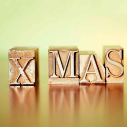 Metal Printing blocks spelling XMAS